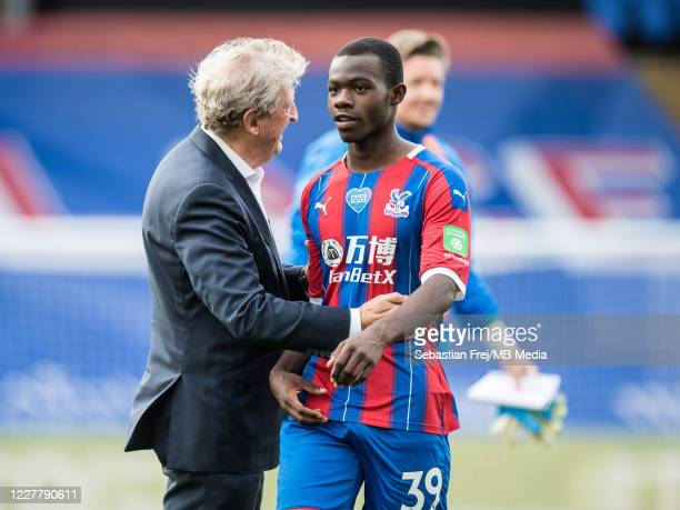 manager Roy Hodgson of Crystal Palace and Tyrick Mitchell of Crystal Palace reaction on pitch after the Premier League match between Crystal Palace...