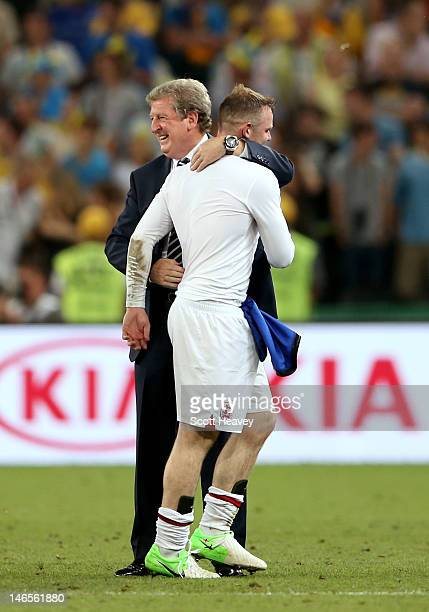 Manager Roy Hodgson of England hugs Wayne Rooney after victory during the UEFA EURO 2012 group D match between England and Ukraine at Donbass Arena...