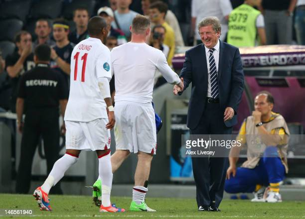 Manager Roy Hodgson of England shakes hands with Wayne Rooney after victory during the UEFA EURO 2012 group D match between England and Ukraine at...