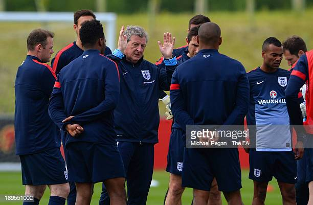Manager Roy Hodgson of England speaks to his players during the England Training Session at St Georges Park on May 27, 2013 in Burton-upon-Trent,...