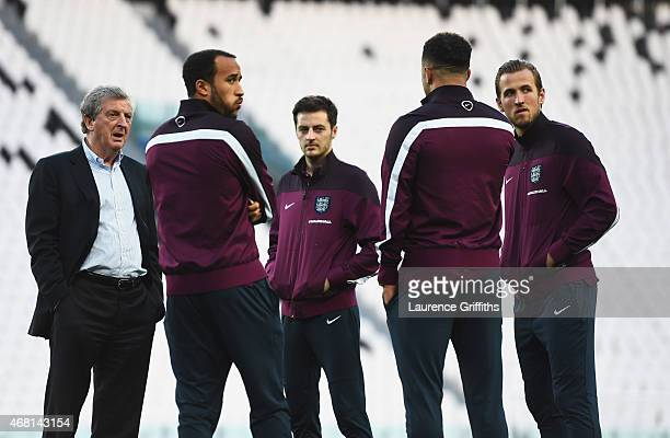 Manager Roy Hodgson of England talks to Andros Townsend Ryan Mason and Harry Kane during an England team stadium visit ahead of the International...