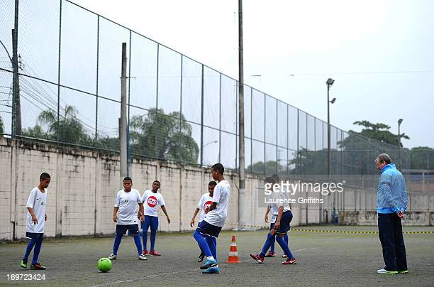 Manager Roy Hodgson of England watches over a training session for local children during a visit to a Sport Relief project on May 31 2013 in Rio de...