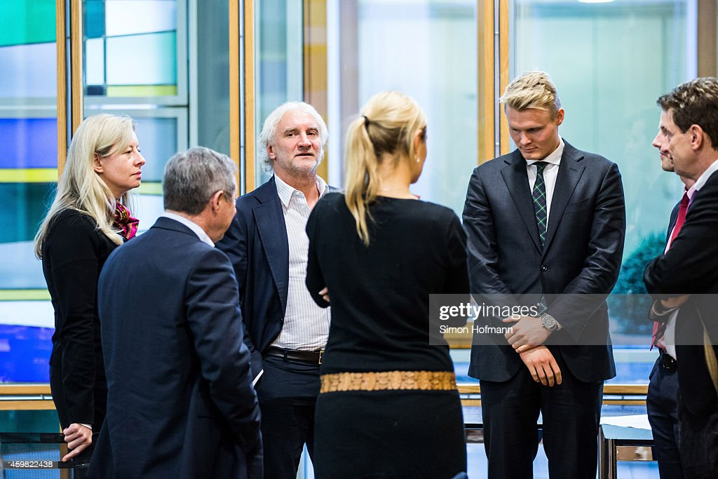 Manager Rudi Voeller (3L) of Bayer Leverkusen attends the decision of DFB Court on the objection to the length of a 3 match ban in the DFB Cup which was given after Heung-Min Son was shown a red card for violent conduct at DFB Headquarter on December 2, 2014 in Frankfurt am Main, Germany.