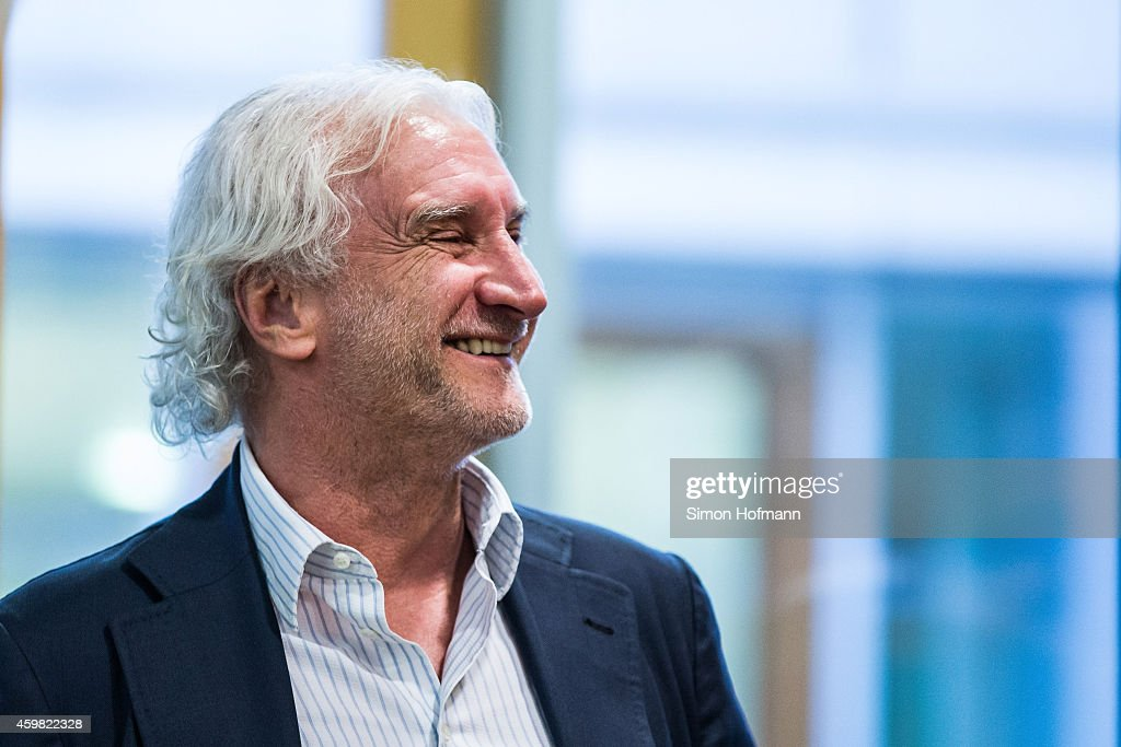 Manager Rudi Voeller of Bayer Leverkusen smiles prior to the decision of DFB Court on the objection to the length of a 3 match ban in the DFB Cup which was given after Heung-Min Son was shown a red card for violent conduct at DFB Headquarter on December 2, 2014 in Frankfurt am Main, Germany.