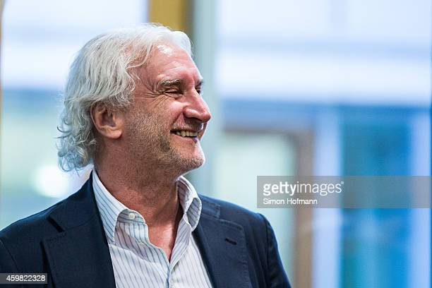 Manager Rudi Voeller of Bayer Leverkusen smiles prior to the decision of DFB Court on the objection to the length of a 3 match ban in the DFB Cup...