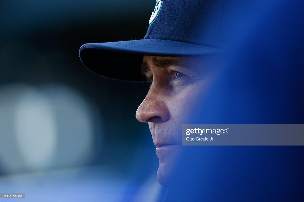 Manager Scott Servais #9 of the Seattle Mariners looks on from the dugout in the fifth inning against the Oakland Athletics at Safeco Field on October 2, 2016 in Seattle, Washington. The Athletics defeated the Mariners 3-2.