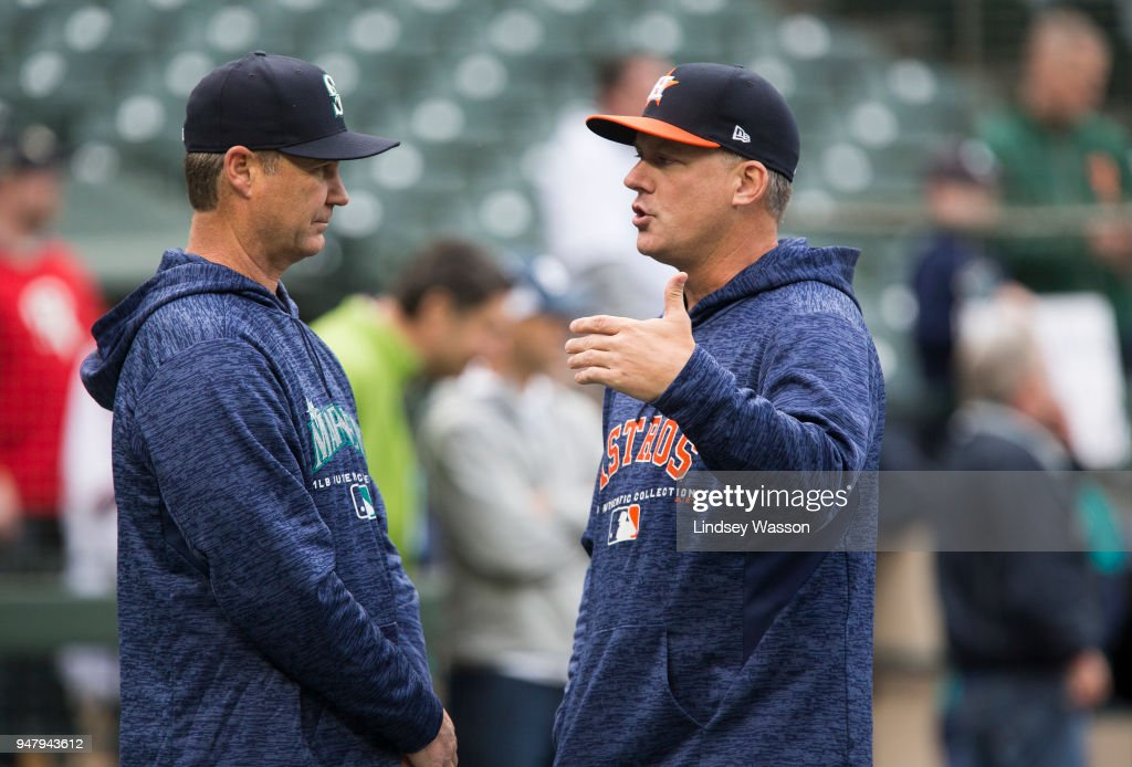 Manager Scott Servais (L) of the Seattle Mariners talks with Manager A.J. Hinch of the Houston Astros during batting practice before the game at Safeco Field on April 17, 2018 in Seattle, Washington.