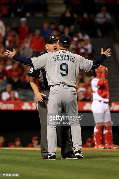 Manager Scott Servais of the the Seattle Mariners argues a call with second base umpire Bill Miller during the sixth inning of a baseball game...