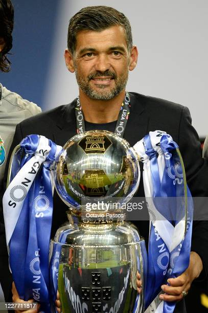 Manager Sergio Conceicao of FC Porto celebrates with the trophy after winning the league title following the Liga Nos match between FC Porto and...