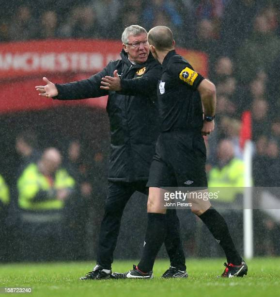 Manager Sie Alex Ferguson of Manchester United complains to referee Mike Dean about a Jonny Evans owngoal during the Barclays Premier League match...