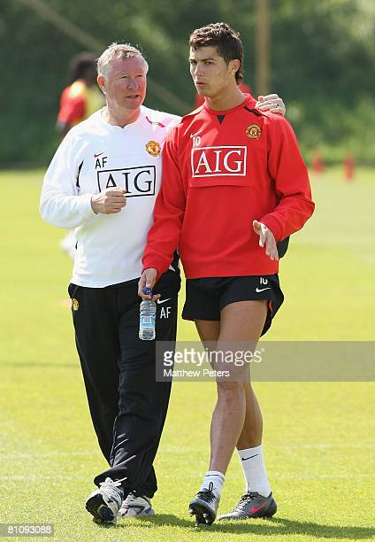 Manager Sir Alex Ferguson and Cristiano Ronaldo of Manchester United attend a First Team training session at Carrington Training Ground on May 15...
