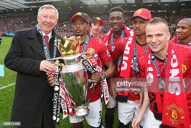 Manager Sir Alex Ferguson and Patrice Evra of Manchester United celebrate with the Premier League trophy after the Barclays Premier League match...