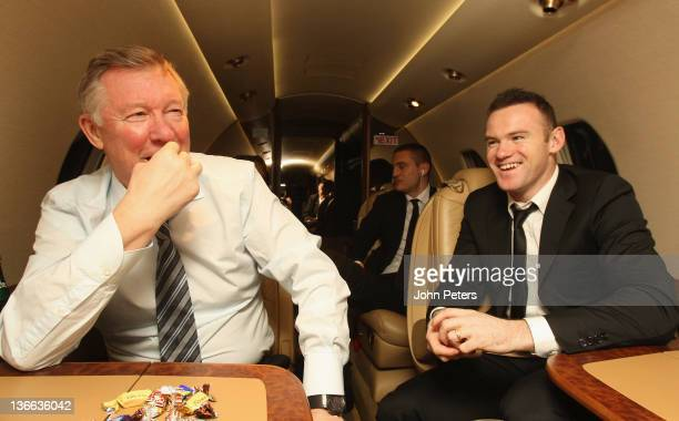 Manager Sir Alex Ferguson and Wayne Rooney of Manchester United talk on the plane home to Manchester after the FIFA Ballon d'Or Gala 2011 at...
