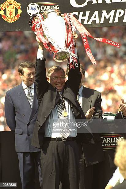Manager Sir Alex Ferguson lifts the Premiership Trophy after the FA Premiership match between Manchester United v Tottenham Hotspur at Old Trafford...