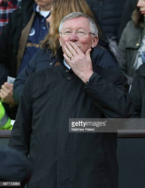 Manager Sir Alex Ferguson of Great Britain and Ireland waves to the crowd ahead of the David Beckham Match for Children in aid of UNICEF between...