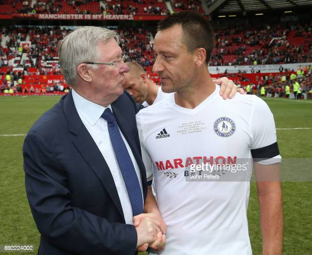 Manager Sir Alex Ferguson of Manchester United '08 XI speaks to John Terry of Michael Carrick AllStars after the Michael Carrick Testimonial match...