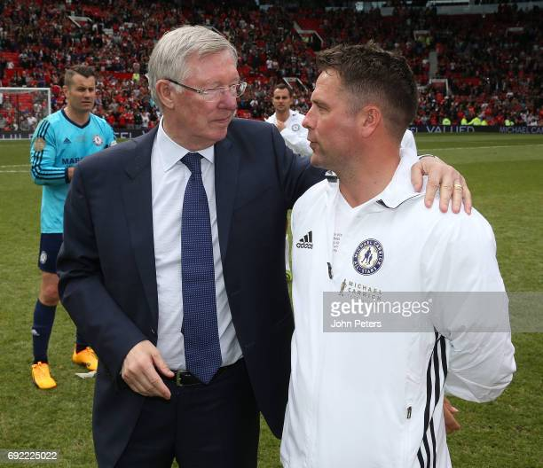 Manager Sir Alex Ferguson of Manchester United '08 XI speaks to Michael Owen of Michael Carrick AllStars after the Michael Carrick Testimonial match...
