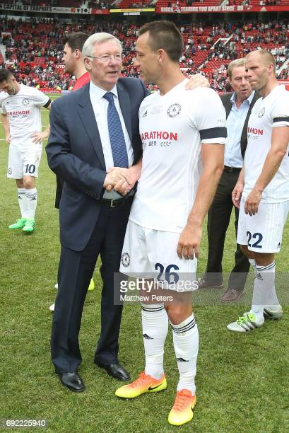 Manager Sir Alex Ferguson of Manchester United '08 XI talks to John Terry after the Michael Carrick Testimonial match between Manchester United '08...