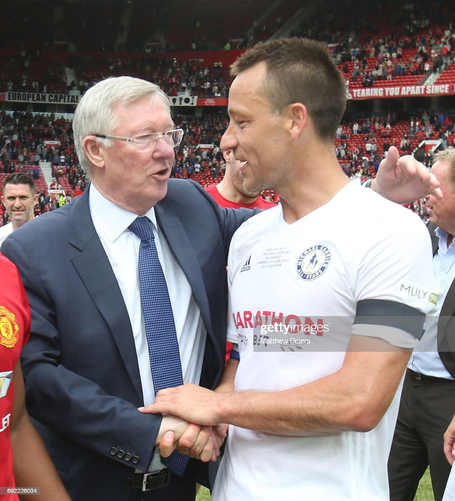 Manager Sir Alex Ferguson of Manchester United '08 XI talks to John Terry after the Michael Carrick Testimonial match between Manchester United '08 XI and Michael Carrick All-Stars at Old Trafford on June 4, 2017 in Manchester, England.