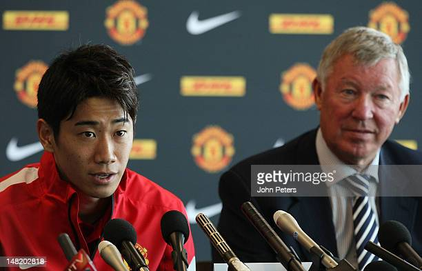 Manager Sir Alex Ferguson of Manchester United and new signing Shinji Kagawa attend a press conference at Old Trafford on July 12 in Manchester,...