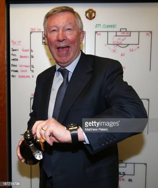 Manager Sir Alex Ferguson of Manchester United celebrates in the dressing room after the Barclays Premier League match between Manchester United and...