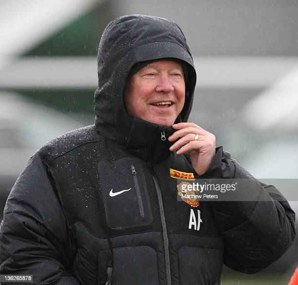 Manager Sir Alex Ferguson of Manchester United in action during a training session at Carrington Training Ground on December 30, 2011 in Manchester,...