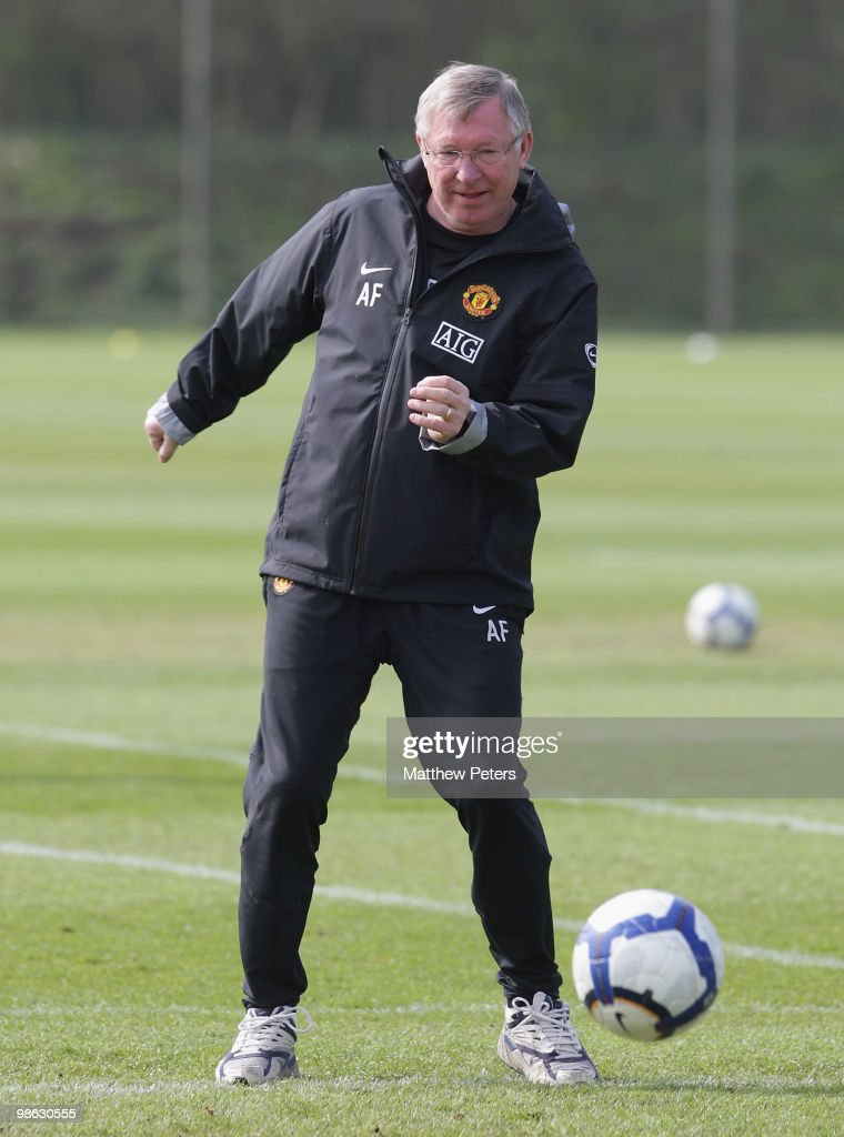 Manager Sir Alex Ferguson of Manchester United in action on the ball during a First Team Training Session at Carrington Training Ground on April 23 2010, in Manchester, England.