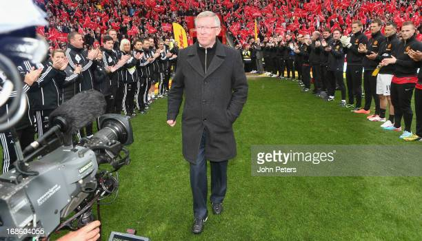 Manager Sir Alex Ferguson of Manchester United is given a guard of honour by both teams ahead of the Barclays Premier League match between Manchester...