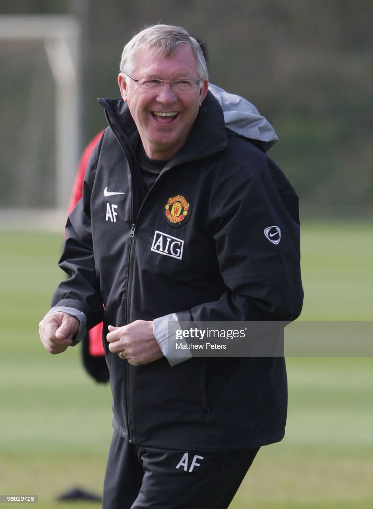 Manager Sir Alex Ferguson of Manchester United laughs during a First Team Training Session at Carrington Training Ground on April 23 2010, in Manchester, England.