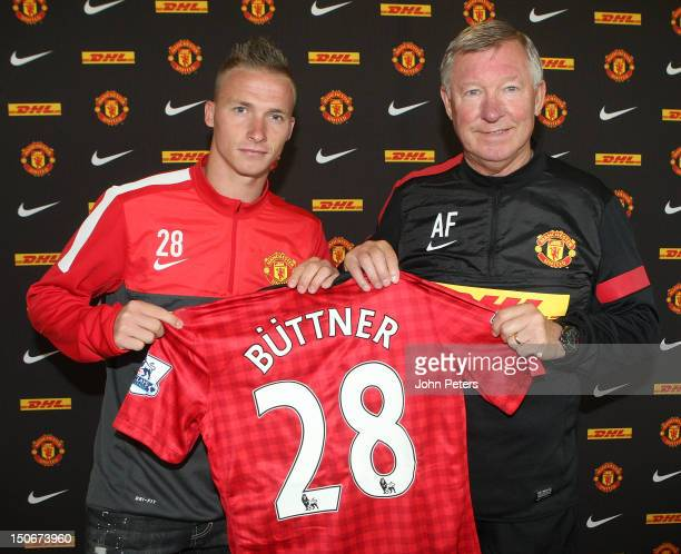 Manager Sir Alex Ferguson of Manchester United poses with Alexander Buttner after a press conference to unveil Buttner as a Manchester United player...