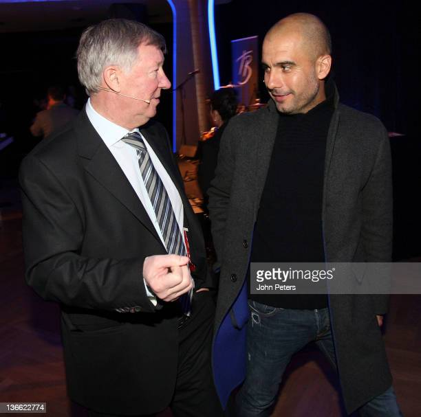 Manager Sir Alex Ferguson of Manchester United poses with Manager Josep Guardiola of Barcelona at the FIFA Ballon d'Or Gala 2011 at Kongresshaus on...