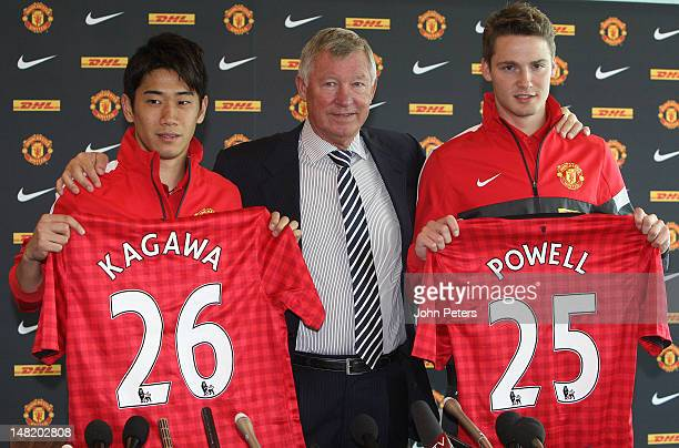 Manager Sir Alex Ferguson of Manchester United poses with new signings Shinji Kagawa and Nick Powell during a press conference at Old Trafford on...