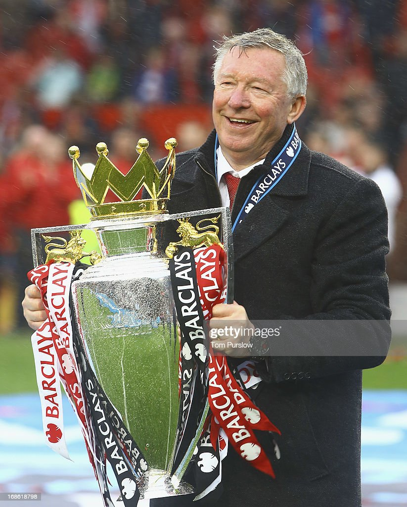 Manager Sir Alex Ferguson of Manchester United poses with the Premier League trophy after the Barclays Premier League match between Manchester United and Swansea at Old Trafford on May 12, 2013 in Manchester, England.