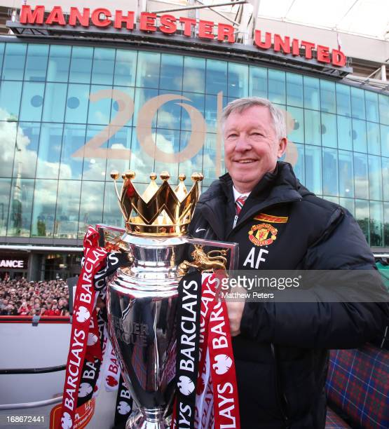 Manager Sir Alex Ferguson of Manchester United poses with the Premier League trophy at the start of the Premier League trophy winners parade on May...