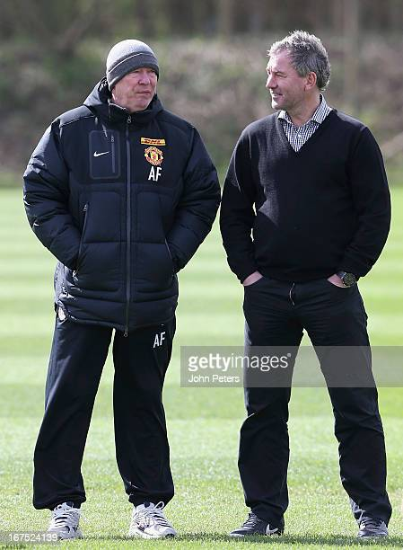 Manager Sir Alex Ferguson of Manchester United talks to Bryan Robson during a first team training session at Carrington Training Ground on April 26...