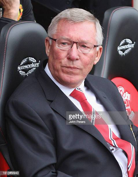Manager Sir Alex Ferguson of Manchester United watches from the dugout during the Barclays Premier League match between Southampton and Manchester...