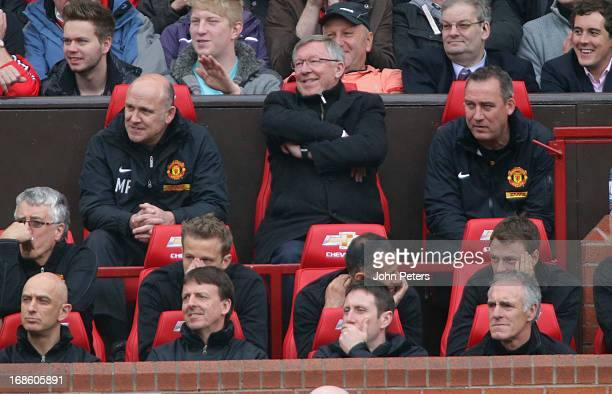 Manager Sir Alex Ferguson of Manchester United watches from the dugout during the Barclays Premier League match between Manchester United and Swansea...