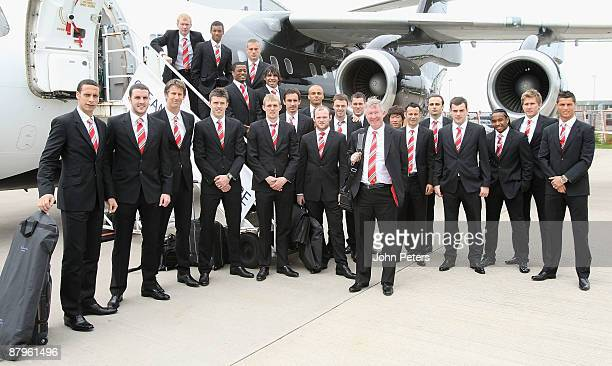 Manager Sir Alex Ferguson poses with the Manchester United squad before their departure for the UEFA Champions League Final in Rome at Manchester...