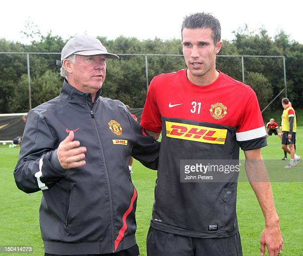 Manager Sir Alex Ferguson talks with new signing Robin van Persie during a Manchester United FC trainining session at their Carrington Training...