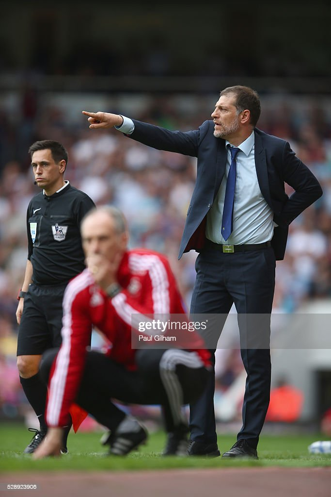 Manager Slaven Bilic of West Ham United shouts out from the touchline as manager Francesco Guidolin of Swansea looks on during the Barclays Premier League match between West Ham United and Swansea City at the Boleyn Ground, May 7, 2016, London, England.