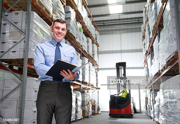 Manager Smiling in a Warehouse