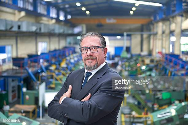 Manager Standing In Factory