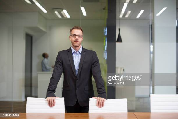 Manager standing in office boardroom