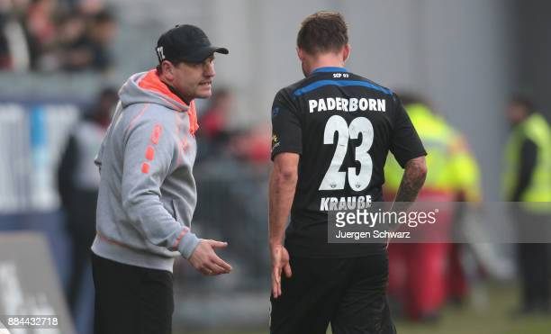 Manager Steffen Baumgart of Paderborn talks to Robin Krausse during the 3 Liga match between SV Wehen Wiesbaden and SC Paderborn 07 at Brita Arena on...