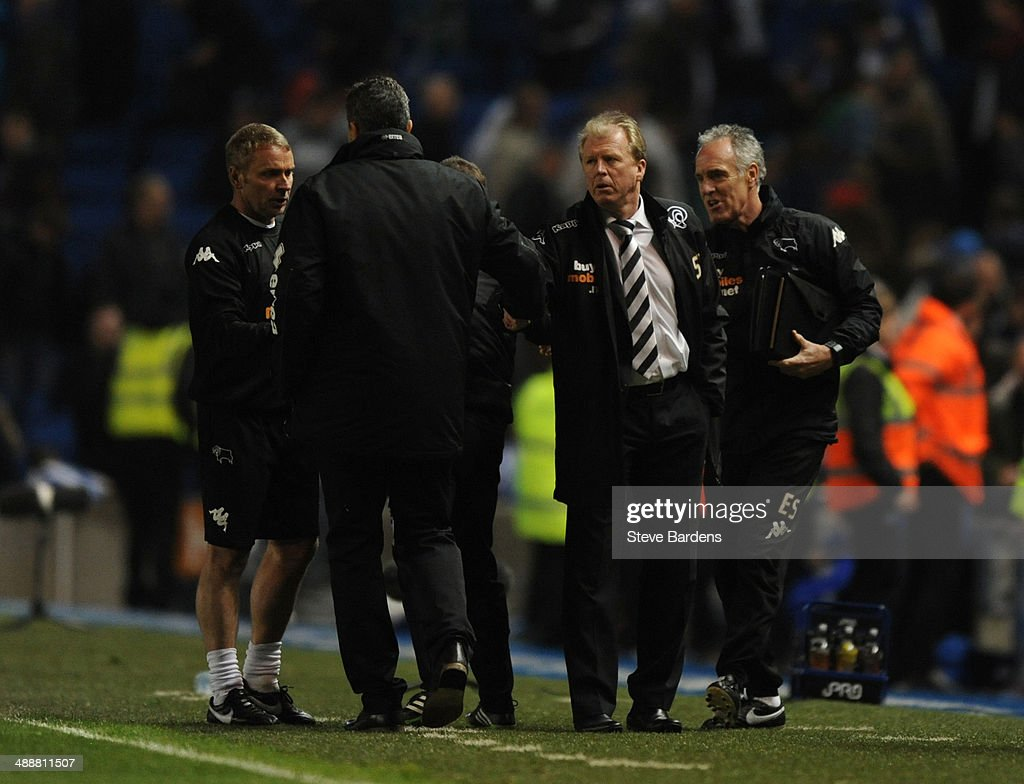 Manager Steve McClaren of Derby County shakes hands with manager Oscar Garcia of Brighton & Hove Albion after the Sky Bet Championship Play Off semi final first leg match between Brighton & Hove Albion and Derby County at Amex Stadium on May 8, 2014 in Brighton, England.