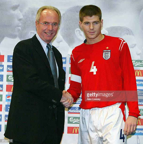 Manager Sven Goran Erikkson of England poses with Steven Gerrard of England after handing him the captains armband during an England press conference...