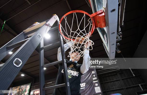 Manager Ta Tsung Chiu of Taiwan Beer cut the nets during the SBL Finals Game Six between Taiwan Beer and Yulon Luxgen Dinos at Hao Yu Trainning...