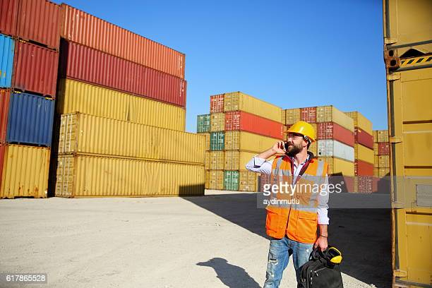 Manager talking on the phone at commercial dock