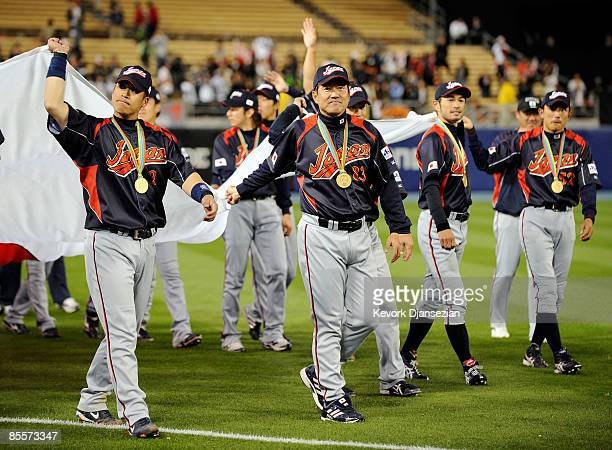 Manager Tatsunori Hara of Japan and his tam carry their nation's flag after defeating Korea 53 during the finals of the 2009 World Baseball Classic...