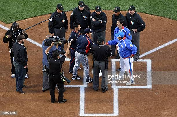 Manager Tatsunori Hara of Japan and manager InSik Kim of Korea shake hands before the finals of the 2009 World Baseball Classic on March 23 2009 at...